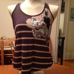 Grey stripe and sequin embellished express tank This is a grey stripe express tank top. It has a sequin design on one side. Worn once great buy for summer! Express Tops Tank Tops