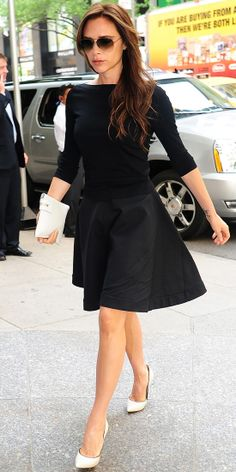 Victoria Beckham hit the street in slim separates that she paired with white leather accessories.