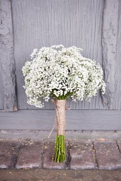 Baby's breath with burlap, inexpensive, DIY and perfect for my bridesmaids:)