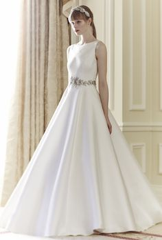 """Brides.com: . """"Audrey"""" sleeveless organza ball gown with embellished waist and high neckline, Jenny Packham."""