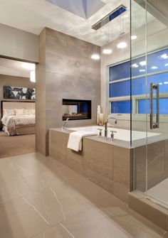 Nice dual fireplace between the bedroom and bathroom. But is it too open? Theres really no bathroom privacy in this layout.