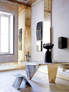 "It was two years ago when architect and sculptor Vincenzo de Cotiis and his wife, Claudia, discovered their 18th-century palazzo apartment in the old neighbourhood of Magenta. ""We'd previously lived in Brera, a very central, busy district,"" he explains. ""I'd always hoped to live in this area, but the right spaces are very hard to find. I wanted somewhere that retained original features, but still needed a lot of work. We were lucky. It was love at first sight whe..."