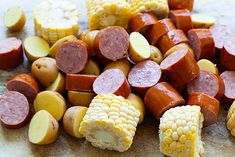 Shrimp boil ingredients: potatoes, smoked sausage and corn, ready to boil with shrimp. Sausage And Shrimp Recipes, Seafood Boil Recipes, Shrimp Recipes Easy, Crab Recipes, Mexican Food Recipes, Cajun Dishes, Seafood Dishes, Shrimp Boil Party