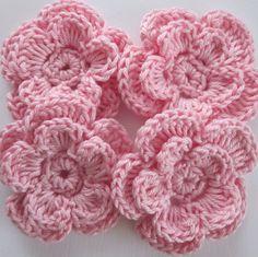 1 Sett med 4 lys  rosa blomster.