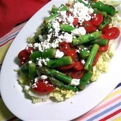 "Fresh Asparagus, Tomato, and Feta Salad | ""This is a fresh summer salad with a light dressing inspired by Mediterranean and Asian flavors."" #asparagus #asparagusrecipes #howtocookasparagus #asparagussides #asparagussalads"