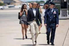 Pin for Later: It Turns Out Malia and Sasha Obama Are Ridiculously Good at Accessorizing Sasha Wore a Striped BCBG Max Azria Dress With Bright Details