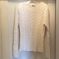 J.Crew White Cotton cable sweater J.Crew 100% cotton cable sweater.  Great weight for summer!  Only been worn a few times so is in excellent condition.  Style is fitted on someone who wears a large, would be slightly oversized on someone who wears a medium! J. Crew Sweaters Crew & Scoop Necks
