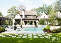 Architect Greg Busch and builder Mike Hammersmith were responsible for the design-build of this fresh abode; interior designer Brian Watford enlisted landscape designer Brian James Davis to create a lush backyard ideal for entertaining.