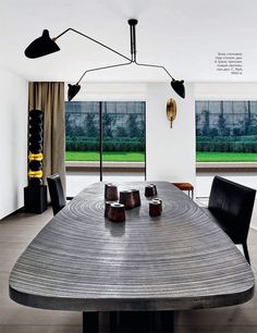 "Apartment in Neuilly-Sur-Seine France by Olivier Dwek - cast aluminum table ""Goutte d'Eau"" by Belgian designer Ado Chale"