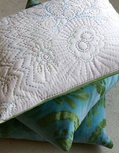 A pillow is a great place to practice your hand quilting stitches.  Creating the pillow front is exactly like creating a quilt top, but because the back side of the stitches will be hidden inside the pillow, you can feel a little less freaked out about your quilt back results as you go.