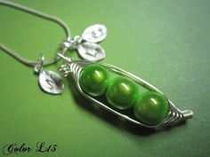wire wrapped peas in a pod necklace, perfect!  love the initial stamps too