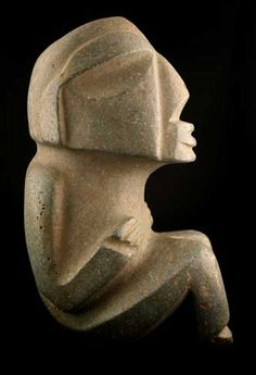 MEZCALA STONE SCULPTURE OF A SEATED MAN. Guerrero, Mexico. 300 BC to 300 AD. 27.3 x 12.7 x 16.5 cm.