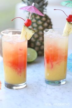 This TROPICAL PARTY PUNCH RECIPE will have you feeling like you're sitting on a warm, sunny beach. It's an easy non-alcoholic party punch recipe everyone can enjoy!
