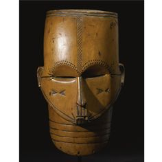 A FINE AND RARE FANG MASK, GABON of hollowed form, with four blackened horizontal incised bands on the neck beneath the protruding facial pl...