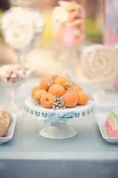 I would kiss a dog for one of these milk glass cake plates with the ribbon slots! *swoon*