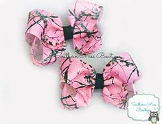 found on southernmissbows on etsy Girl's Camo Hairbow; Baby bow; Pink Camo Pigtail Boutique Hair bow set, Piggy bows, Pigtail bows, Pink and black camouflage boutique bows