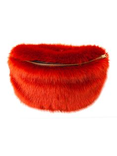 99dd5c3726b25 Red Livi Bum Bag: Faux fur bum bag from Baum und Pferdgarten. It has an  adjustable belt strap and closes with a golden buckle.