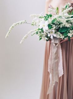 Soft Spring wedding bouquet by Sarah Winward in shades of white.
