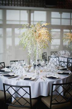 Pretty centerpiece! Love the vases.