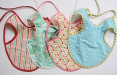 Bought one of these at a craft show a couple of years ago...it's one of my favorite bibs for Julia cuz it covers everything...now I can make them myself!!