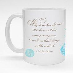 """Love the Sea"" Robert Henri quote mug.  Seashell wrap-around design.  Ceramic coffee mug is made to order and dishwasher safe."