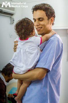 October 25: An International Medical Corps ICU nurse smiles as he cares for a child at Zintan Hospital in Libya. Photo: Jaya Vadlamudi, International Medical Corps, Libya 2012