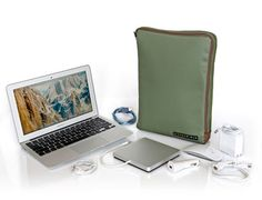 Air wallet.  A pocket for every accessory and a should strap. http://www.sfbags.com/products/macbookair-wallet/macbookair-wallet.php