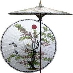 """Asian Splendor 7 Foot Patio Umbrella With Base - Lily White by Oriental Decor. $249.95. Masterfully handcrafted and hand-painted with beautiful Asian and floral-themed designs.. 1 1/2"""" 2-piece pole fits securely into any standard patio umbrella base or patio table.. All patio umbrellas ship with 4-day UPS air.. The hand-painted umbrella shade is oil-treated for a glossy, water-repellant finish.. Durable frame made from stained oak hardwood.. A lone juniper tree proudly stands u..."""