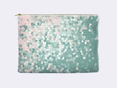 Choose between two sizes for this fun zippered pouch in rose quartz pink and mint print. The printed mosaic pattern fades from pink to mint. The artwork is professionally printed on both sides. The bag is made from polyester poplin and has a non-woven laminate interior. This durable cosmetic bag is machine washable in cold water.  This makeup bag also comes in a pretty pale yellow with serenity blue.  These zippered pouches can be used for toiletries, makeup, as a pencil case or even as a…