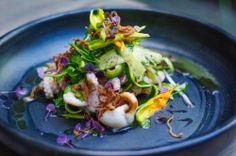 Grilled Baby Octopus Salad with zucchini flowers, soft herbs & jalapeño oil