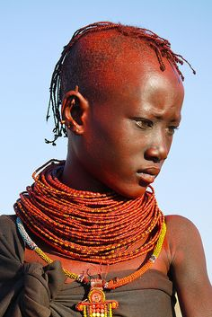 Africa | Portrait of a young Turkana girl with braided hair and tradional beaded necklace, Kenya | © Rita Willaert