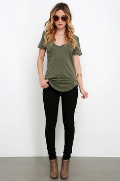 The V neck, short sleeves, and patch pocket keep the classic tee look on this olive green top, but the jersey knit fabric has a slub texture.  like the whole outfit and casualness + especially the olive green