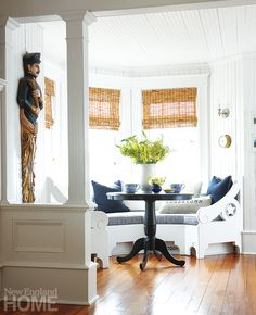 Hilary and Damien Breier's home - A built-in breakfast seat secures a front-row view to the morning workings of the harbor.   New England Home Magazine