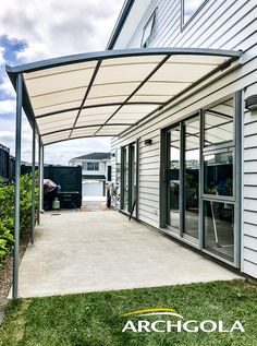 Looking to extend your living space? Add an Archgola to your home and it's like adding a new room, for a fraction of the price. Archgola awnings are custom-made to your style and budget. Customise your Archgola awning design, frame colours and roof tints, to achieve the shade and shelter you're looking for. Call us now on 0508 272 446 for a FREE measure & quote. Building Ideas, Building A House, Pergola Patio, Backyard, Outdoor Awnings, Roof Shapes, Outdoor Shelters, Outdoor Shade, Home Flowers