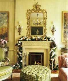 Living room mantel decorated by New York florist Zezé - velvet ribbons, pinecones, ornaments - home of Charlotte Moss