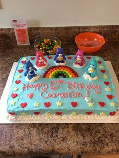 Care Bears birthday cake with skittles for rainbow, fondant cut outs and figurines! Not bad for an amateur.