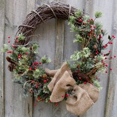 i like these materials too for the centerpieces... maybe less berries/different color berries (Kris has some purple ones) Woodland Christmas Berries and Pine Wreath From procelebrations on Etsy.com