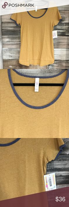 NWT. LuLaRoe Classic Tee NWT. LuLaRoe Classic Tee. Yellow with blue trim around neck and arms. Material is a lightweight sweater like fabric. Very comfy! LuLaRoe Tops Tees - Short Sleeve