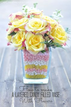 Jellybean flower holder   http://www.getcreativejuice.com/2014/05/how-to-make-a-layered-candy-filled-vase-with-flowers.html