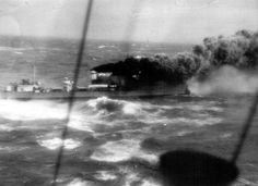 British destroyer HMS Glowworm recoiling from German heavy cruiser Admiral Hipper after ramming her off Norway in April 1940 - it can be seen that her bows are stove in. This famous action won her Commanding Officer a posthumous Victoria Cross, not least because of tributes from her opponents.