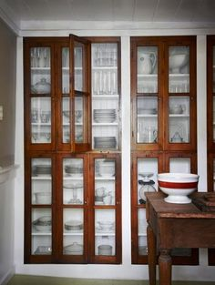 vintage built-in shelving. paint the back of the shelves the same color of the walls.