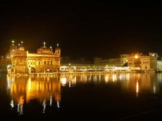 Golden Temple, - India- I was there and it looks exactly like that. Amazing