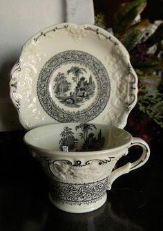 Antique Black & Cream Staffordshire Transferware Tea Cup and Saucer Genoa Embossed Floral Border