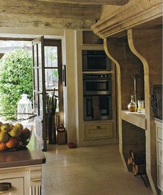 Antique stone fireplace in kitchen