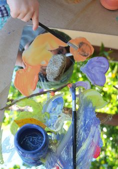 Painting on mirrors toddler activity. Press paper on the wet paint for a monoprint.