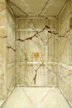 """Marble Master Shower--very plain, but I love the """"paneled"""" look.  This needs way more shower heads and a glass door to keep in the steam!"""
