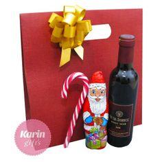 Cadou Santa in the Box este un cadou deosebit cu ciocolata, vin si acadea.