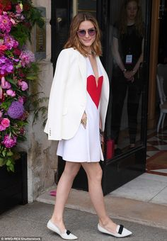 Chic: The former The City star threw a smart jacket over her shoulders, which commanded attention with an embroidered red hand holding a heart plastered on the chest