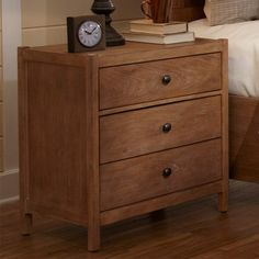 Refresh your master suite or guest room with this understated wood nightstand, showcasing 3 drawers and a natural finish.   Product: ...