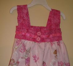 Back of fairy sundress with ruffled straps/chest band.